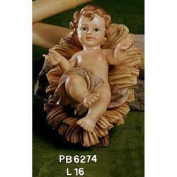 Statua Bambinello su mangiatoia cm 16 in resina