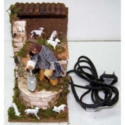 Pastore con agnello in movimento per Presepe cm 14x10x14