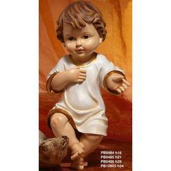 Statua Bambinello vestito in resina cm 34